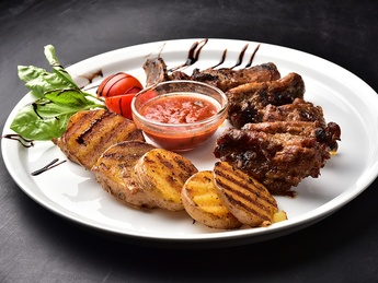 Pork ribs with grilled potato