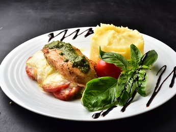 Chicken breast baked with mozarelly and pesto