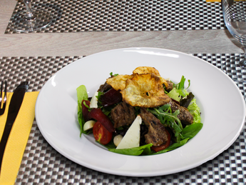 Mix salad with veal medallions