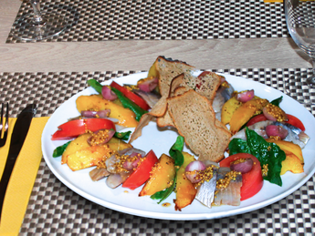 Herring with potatoes and fresh tomatoes