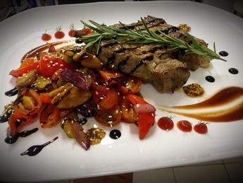Beef tenderloin steak with vegetable sauce and sauce