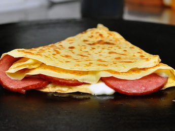 Pancake with salami and cheese