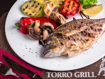 Gilthead cooked on BBQ with vegetables