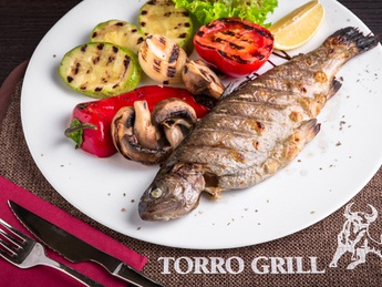 Trout cooked on BBQ with vegetables