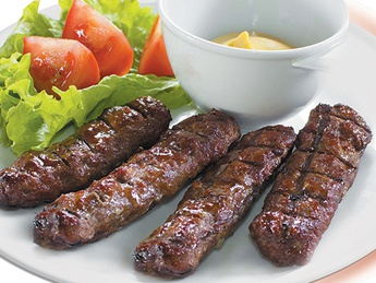 Mici with mustard