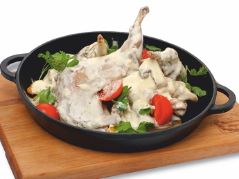 Rabbit with mushrooms in frying pan