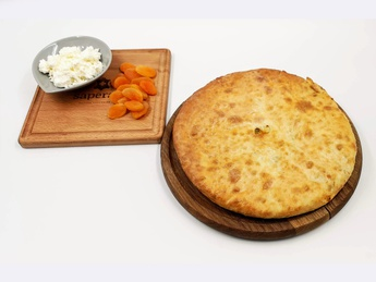 Ossetian pie with apricot, peach and curd