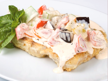 Perch fillet with vegetables in white sauce