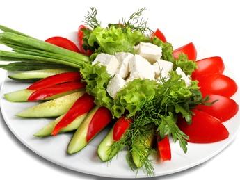 Fresh vegetables with brined cow`s milk cheese
