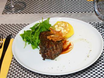 Tenderloin steak with baked potatoes