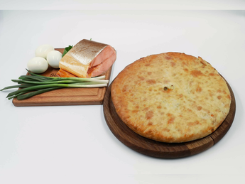 Ossetian pie with smoked salmon, egg and onions