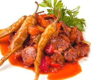 Veal with vegetables in spicy sauce
