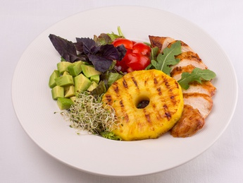 Salad with chicken fillet, avocado and pineapple