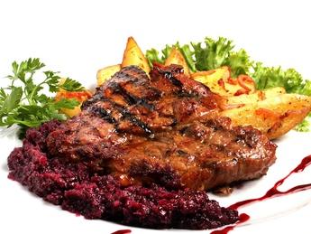 Grilled pork steak, marinated in Kozel beer