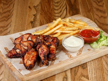 Chicken wings in barbecue and bbq sauces