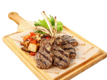 Grilled lamb rack with sauteed vegetables