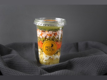 Olivier salad with pesto sauce topping