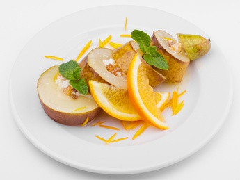 Baked pear with cottage cheese topping and dried fru