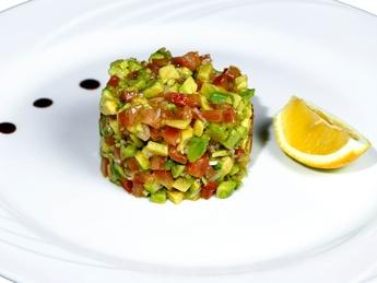 Tartar sauce with avocado and tomato