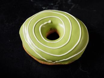 Donuts with pistachios glaze