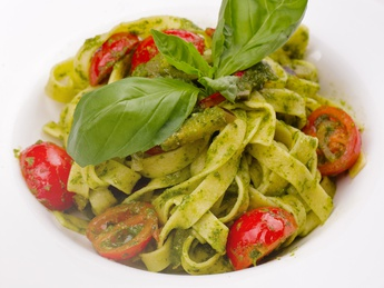 Vegetarian pasta with pesto and cherry tomatoes