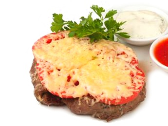 Veal fillet with tomatoes and cheese