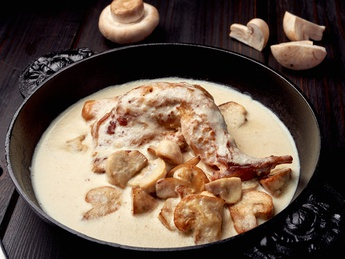 Baked rabbit in a sour cream and mushroom sauce