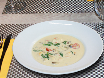 Creamy soup with seafood