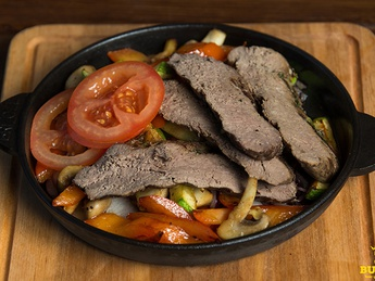 Hot frying pan with veal