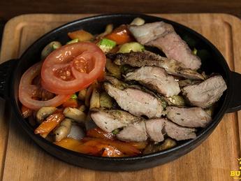 Hot skillet with pork