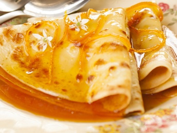 Pancake with orange sauce