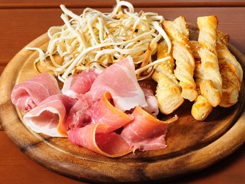Prosciutto with chopsticks of smoked cheese