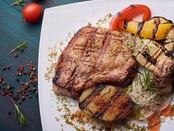 Pork steak with grilled veggies