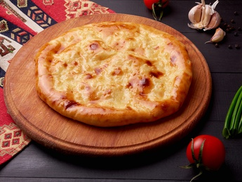 Khachapuri with cheese and herbs