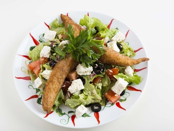 Warm salad with fried chicken fillet
