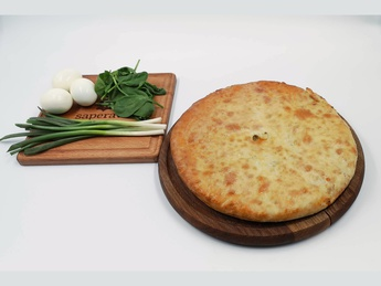 Ossetian pie with egg, spinach and green onions