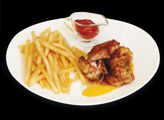 Grilled chicken wings with French fries