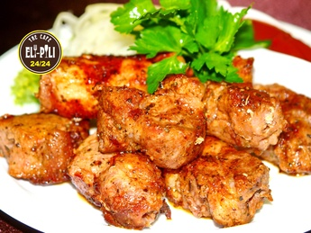 Shish kebab from pork on a grill