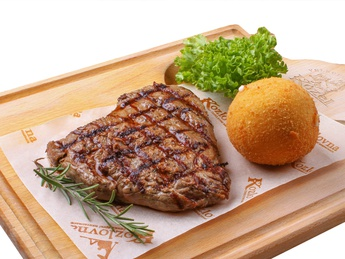 Beef steak with mashed potato ball
