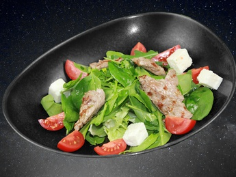 Warm salad with grilled beef