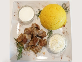 Polenta with stewed meat,sheep cheese and sour cream