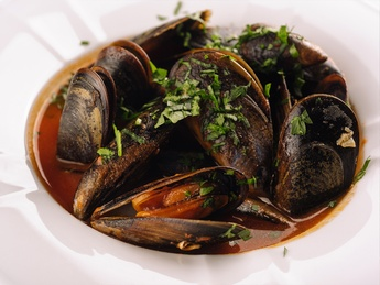 Mussels soup with tomatoes