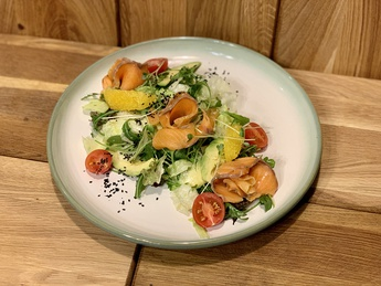 Salad from Norwegian salmon, avocado and honey-olive dressing