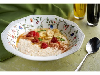 Oatmeal with orange honey, banana and apple