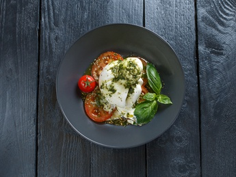 Buratta with tomatoes and pesto
