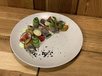 Danube herring with potatoes and a quail egg