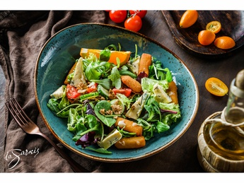 Salad with orange and grilled goat cheese