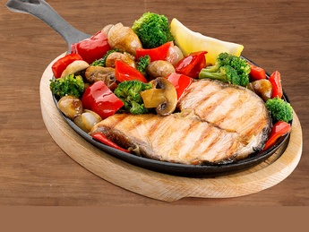 Oven salmon steak with vegetables