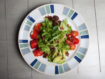 Salad with avocado, pepper, cherry tomatoes and feta