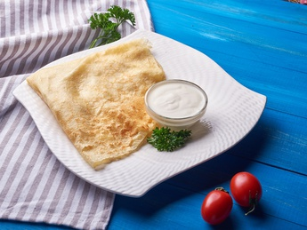 Pancake with butter and sour cream